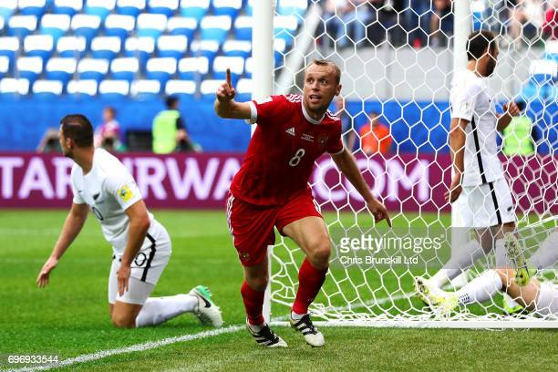 Denis Glushakov of Russia celebrates scoring the opening goal during the FIFA Confederations Cup Group A match between Russia and New Zealand at...