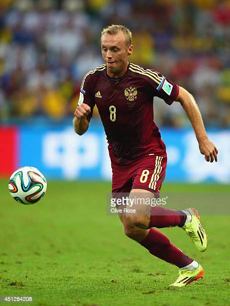 Denis Glushakov of Russia controls the ball during the 2014 FIFA World Cup Brazil Group H match between Algeria and Russia at Arena da Baixada on...