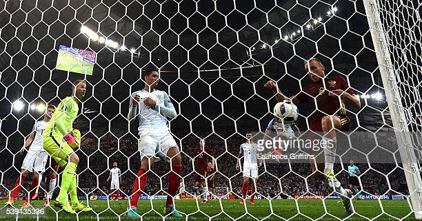 Denis Glushakov of Russia follows the ball into the net as Vasili Berezutski of Russia scores his team's first goal during the UEFA EURO 2016 Group B...