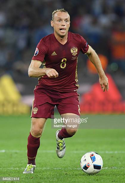 Denis Glushakov of Russia in action during the UEFA EURO 2016 Group B match between Russia and Slovakia at Stade PierreMauroy on June 15 2016 in...