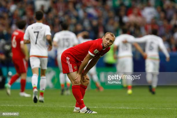 Denis Glushakov of Russia national team reacts as Mexico national team players celebrate a goal during the Group A - FIFA Confederations Cup Russia...