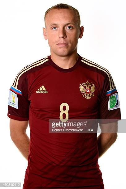 Denis Glushakov of Russia poses during the Official FIFA World Cup 2014 portrait session on June 9 2014 in Sao Paulo Brazil