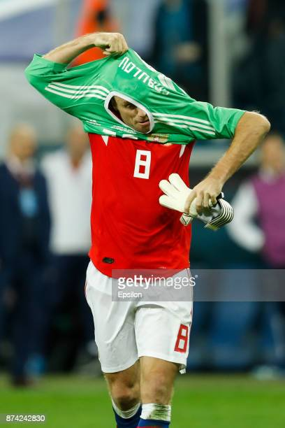 Denis Glushakov of Russia puts on goalkeeper shirt during Russia and Spain International friendly match on November 14 2017 at Saint Petersburg...