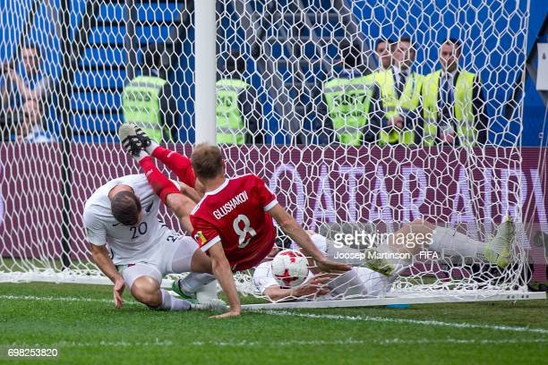 Denis Glushakov of Russia scores a goal during a group A match between Russia and New Zealand at Saint Petersburg Stadium on June 17, 2017 in Saint...