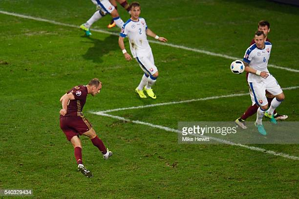 Denis Glushakov of Russia scores his sides first goal during the UEFA EURO 2016 Group B match between Russia and Slovakia at Stade PierreMauroy on...