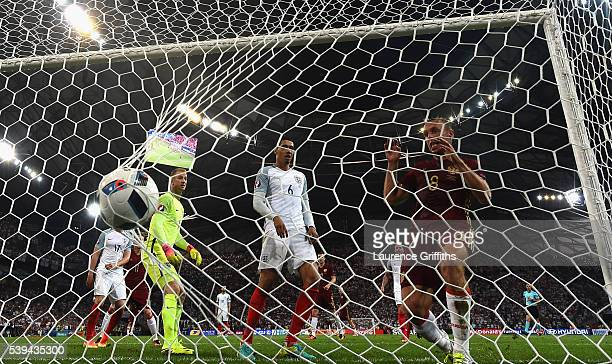 Denis Glushakov of Russia taps in as Vasili Berezutski of Russia score his team's first goal during the UEFA EURO 2016 Group B match between England...