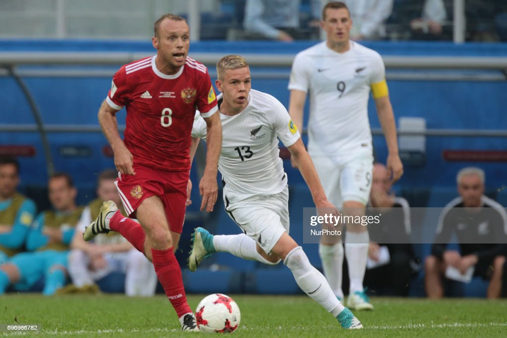 Denis Glushakov (L) of the Russian national football team and Monty Patterson of the New Zealand national football team vie for the ball during the 2017 FIFA Confederations Cup match, first stage - Group A between Russia and New Zealand at Saint Petersburg Stadium on June 17, 2017 in St. Petersburg, Russia.
