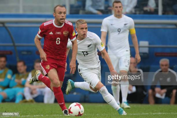 Denis Glushakov of the Russian national football team and Monty Patterson of the New Zealand national football team vie for the ball during the 2017...
