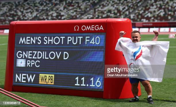 Denis Gnezdilov of Team Russian Paralympic Committee reacts after winning gold medal and breaking the World record in Men's Shot Put - F40 on day 5...