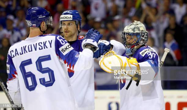 Denis Golda, goaltender of Slovakia celebrate with Erik Cernak and Michal Cajkovsky after the 2019 IIHF Ice Hockey World Championship Slovakia group...