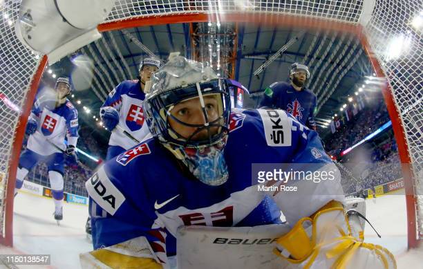 Denis Golda, goaltender of Slovakia tends net against Great Britain during the 2019 IIHF Ice Hockey World Championship Slovakia group A game between...
