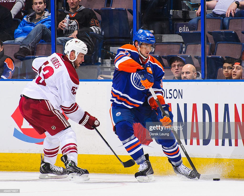 Denis Grebeshkov #37 of the Edmonton Oilers skates against the Phoenix Coyotes during an NHL game at Rexall Place on December 3, 2013 in Edmonton, Alberta, Canada. The Coyotes defeated the Oilers 6-2.