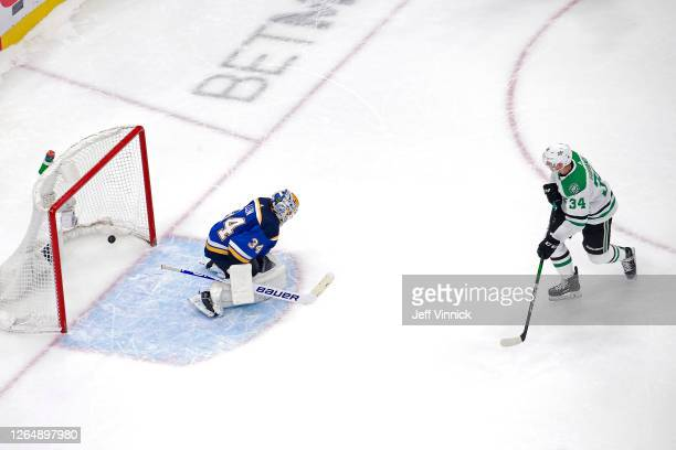 Denis Gurianov of the Dallas Stars scores the game winning goal past Jake Allen of the St. Louis Blues during the overtime shootout in a Western...