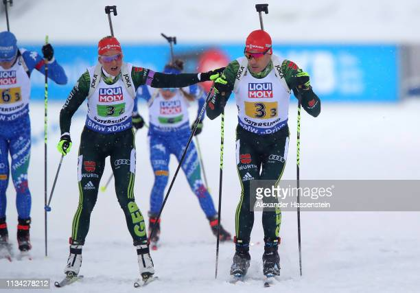 Denis Herrmann.2 of Germany hands over to team mate Arnd Peiffer.3 during the IBU Biathlon World Championships Mixed Relay at Swedish National...