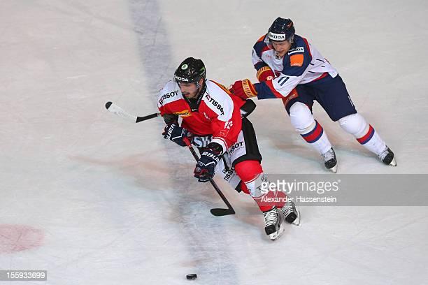 Denis Hollenstein of Switzerland skates againts Rastislav Spirko of Slovakia during the German Ice Hockey Cup 2012 first round match between...