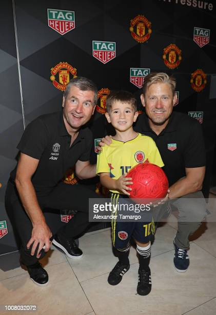 Denis Irwin and Peter Schmeichel pose with fans at the Launch of New TAG Heuer Manchester United Watches at the TAG Heuer Boutique on July 30 2018 in...