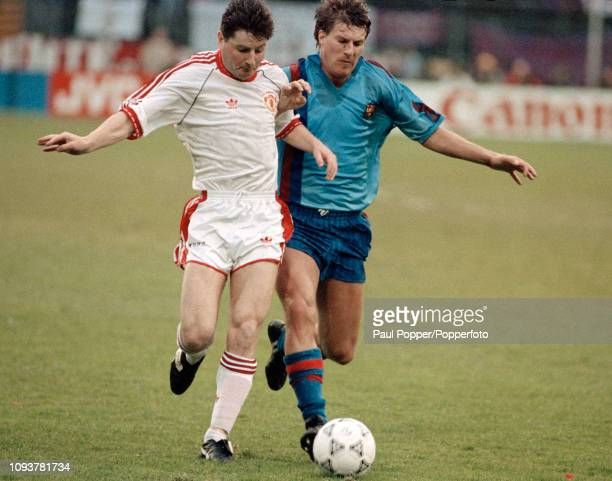 Denis Irwin of Manchester United and Michael Laudrup of Barcelona battle for the ball during the European Cup Winners' Cup Final between Manchester...