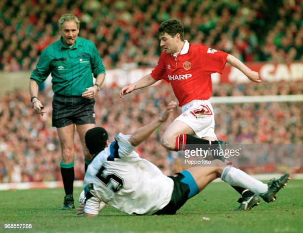 Denis Irwin of Manchester United goes past Paul McGrath of Aston Villa during an FA Premier League match at Old Trafford on March 14 1993 in...