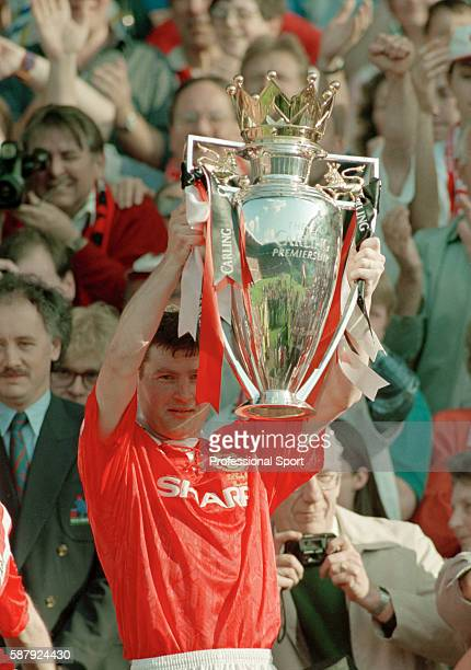 Denis Irwin of Manchester United holding the Premier League Championship trophy after their final home game of the season against Coventry City at...