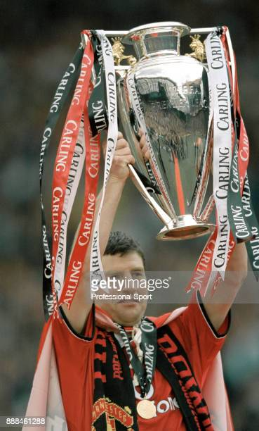 Denis Irwin of Manchester United lifts the FA Carling Premiership trophy after the final home game of the season against Derby County at Old Trafford...