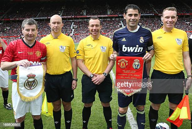 Denis Irwin of Manchester United swaps flags with Real Madrid for the MU Foundation Charity Legends match between Manchester United Legends and Real...