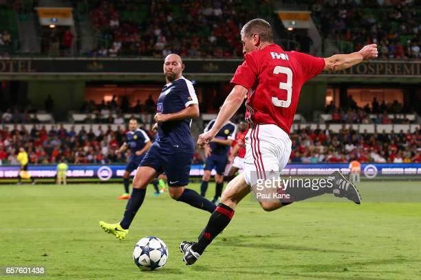 Denis Irwin of the Manchester United Legends crosses the ball during the Manchester United Legends and the PFA Aussie Legends match at nib Stadium on...