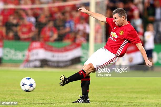 Denis Irwin of the Manchester United Legends passes the ball during the Manchester United Legends and the PFA Aussie Legends match at nib Stadium on...