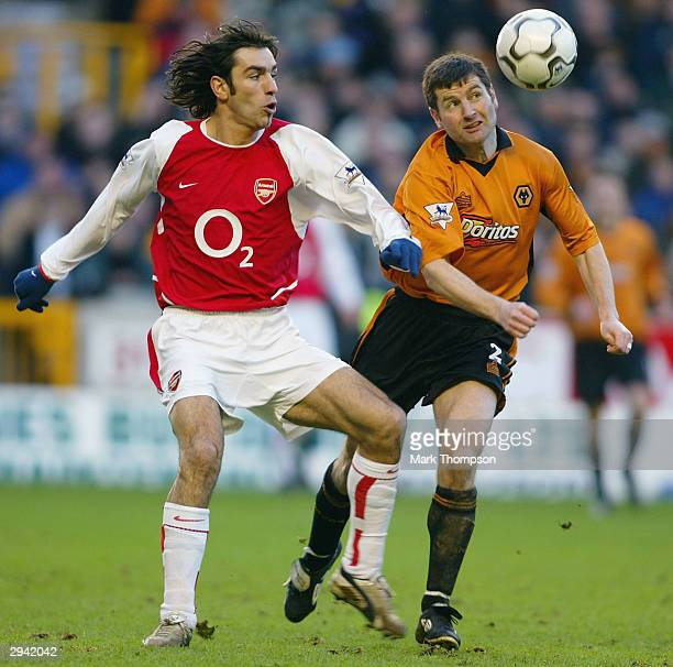 Denis Irwin of Wolves controls the ball as Robert Pires of Arsenal looks on during the FA Barclaycard Premiership match between Wolverhampton...