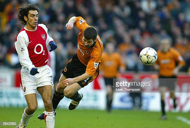 Denis Irwin of Wolves is tackled off his feet by Robert Pires during the FA Barclaycard Premiership match between Wolverhampton Wanderers and Arsenal...
