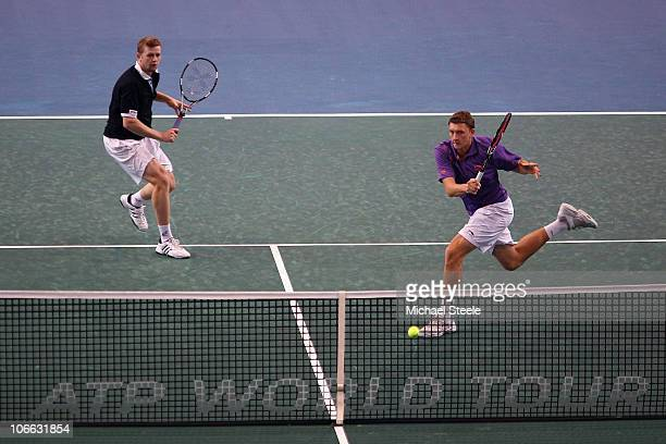 Denis Istomin of Uzbekhistan with doubles partner Andrey Golubev of Kazahkstan in action against Marin Cilic and Ivan Ljubicic of Croatia during Day...