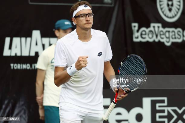 Denis Istomin of Uzbekistan celebrates after winning his match against Philipp Kohlschreiber of Germany during day 2 of the Mercedes Cup at...