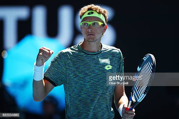 Denis Istomin of Uzbekistan celebrates in his second round match against Novak Djokovic of Serbia on day four of the 2017 Australian Open at...