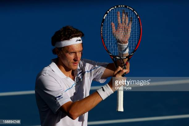 Denis Istomin of Uzbekistan celebrates winning his match against Lleyton Hewitt of Australia on day five of the Brisbane International at Pat Rafter...