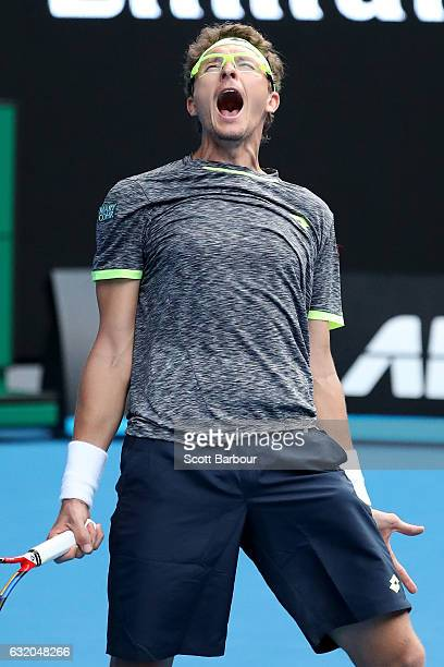 Denis Istomin of Uzbekistan celebrates winning his second round match against Novak Djokovic of Serbia on day four of the 2017 Australian Open at...