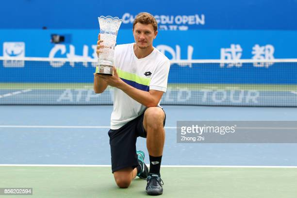 Denis Istomin of Uzbekistan celebrates with trophy after Marcos Baghdatis of Cyprus retired from the men's singles final on Day 7 of 2017 ATP Chengdu...