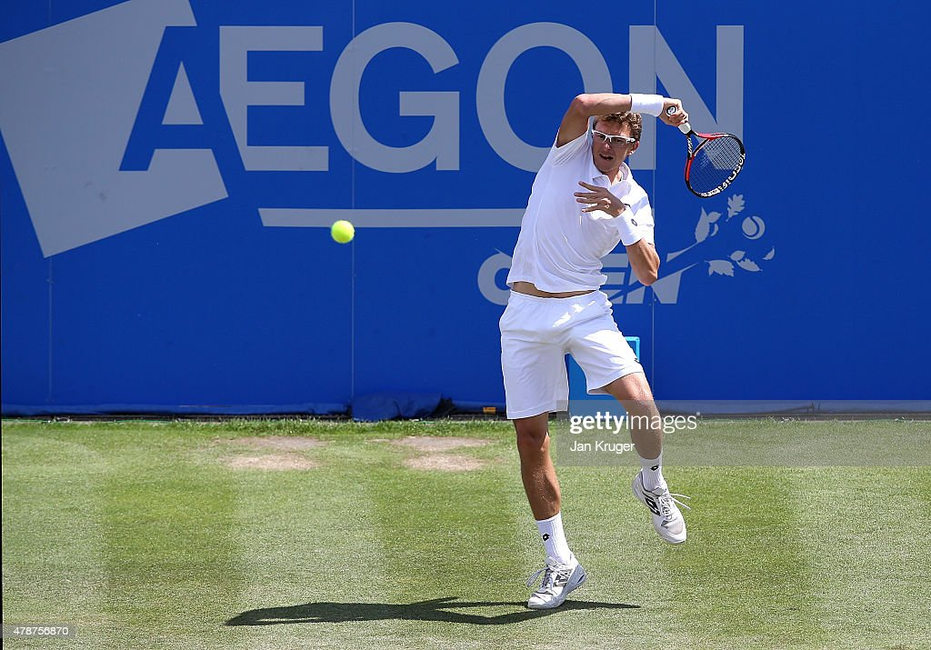 Denis Istomin of Uzbekistan in action against Sam Querrey of USA during the mens singles final match on day seven of the Aegon Open Nottingham at Nottingham Tennis Centre on June 27, 2015 in Nottingham, England.