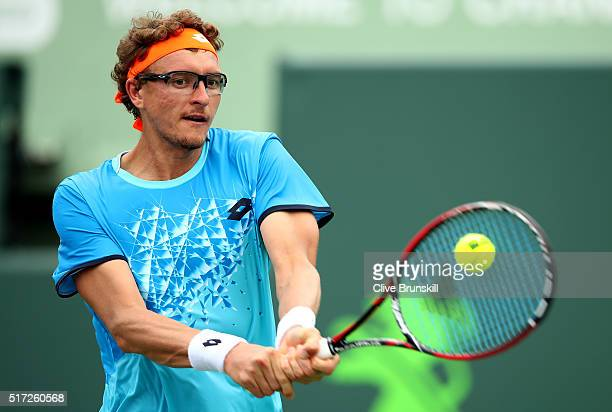 Denis Istomin of Uzbekistan plays a backhand against Borna Coric of Croatia in their first round match during the Miami Open Presented by Itau at...