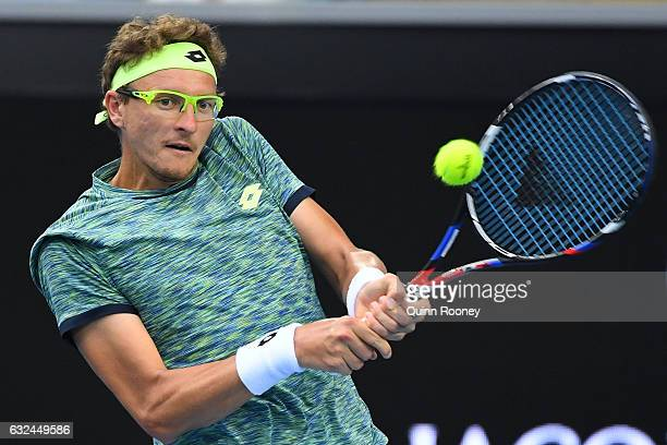 Denis Istomin of Uzbekistan plays a backhand in his fourth round match against Grigor Dimitrov of Bulgaria on day eight of the 2017 Australian Open...
