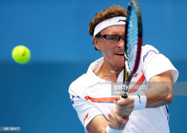 Denis Istomin of Uzbekistan plays a backhand in his second round match against Fernando Verdasco of Spain during day four of the Sydney International...