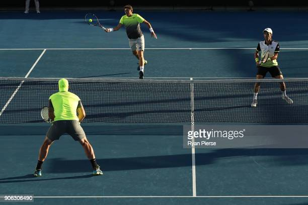 Denis Istomin of Uzbekistan plays a forehand in his first round men's doubles match with Mikhail Kukushkin of Kazakhstan against Sam Groth of...