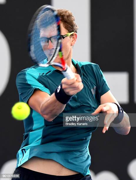 Denis Istomin of Uzbekistan plays a forehand in his match against Ryan Harrison of USA during day six of the 2018 Brisbane International at Pat...
