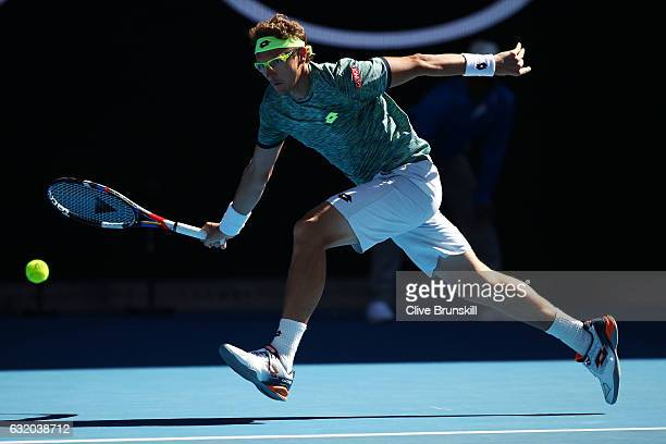 Denis Istomin of Uzbekistan plays a forehand in his second round match against Novak Djokovic of Serbia on day four of the 2017 Australian Open at...