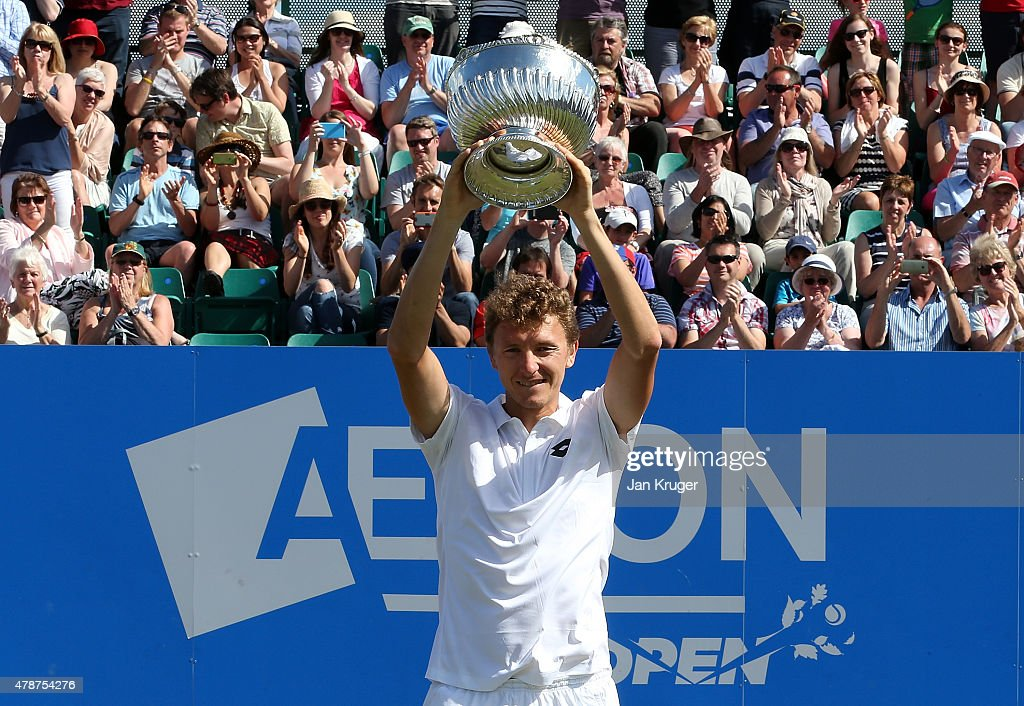 Denis Istomin of Uzbekistan poses with the trophy after victory over Sam Querrey of USA during the mens singles final match on day seven of the Aegon Open Nottingham at Nottingham Tennis Centre on June 27, 2015 in Nottingham, England.