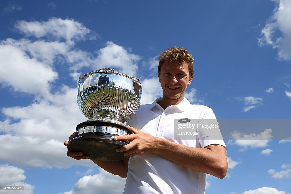 Denis Istomin of Uzbekistan poses with the trophy after victory over Sam Querrey of the United States during the mens singles final match on day seven of the Aegon Open Nottingham at Nottingham Tennis Centre on June 27, 2015 in Nottingham, England.