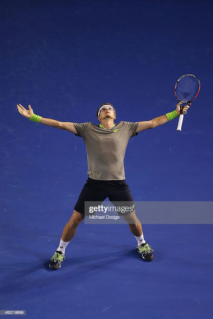 Denis Istomin of Uzbekistan reacts after hitting a winner in his match against Novak Djokovic of Serbia during day five of the 2014 Australian Open at Melbourne Park on January 17, 2014 in Melbourne, Australia.