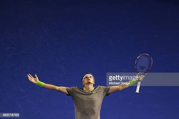 Denis Istomin of Uzbekistan reacts after hitting a winner in his match against Novak Djokovic of Serbia during day five of the 2014 Australian Open...