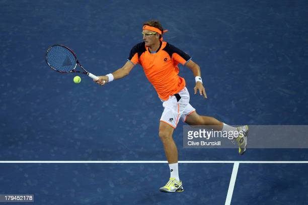 Denis Istomin of Uzbekistan returns a forehand during his men's singles fourth round match against Andy Murray of Great Britain on Day Nine of the...
