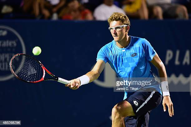 Denis Istomin of Uzbekistan returns a shot from JoWilfried Tsonga of France during the second day of the WinstonSalem Open at Wake Forest University...