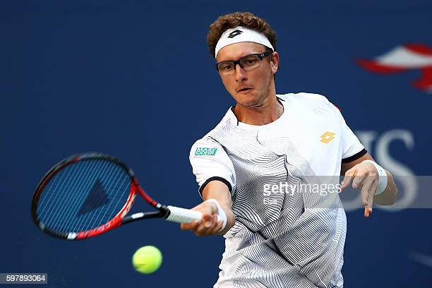 Denis Istomin of Uzbekistan returns a shot to Rafael Nadal of Spain during his first round Men's Singles match on Day One of the 2016 US Open at the...