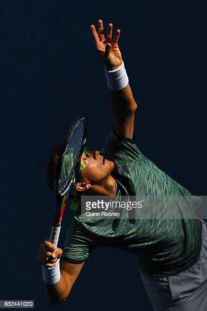 Denis Istomin of Uzbekistan serves in his fourth round match against Grigor Dimitrov of Bulgaria on day eight of the 2017 Australian Open at...
